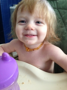 "Naked Baby Feeding Herself, Wearing Amber. Definitely ""Natural"" Enough"